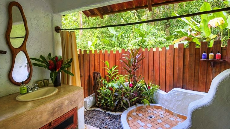 Private open-air garden bathrooms at Nicuesa Lodge exemplify the hotel's harmony with nature philosophy